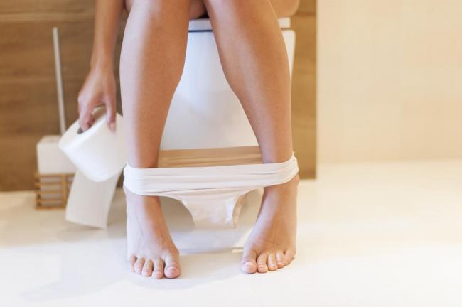 1571193037_woman-sat-on-toilet.jpeg
